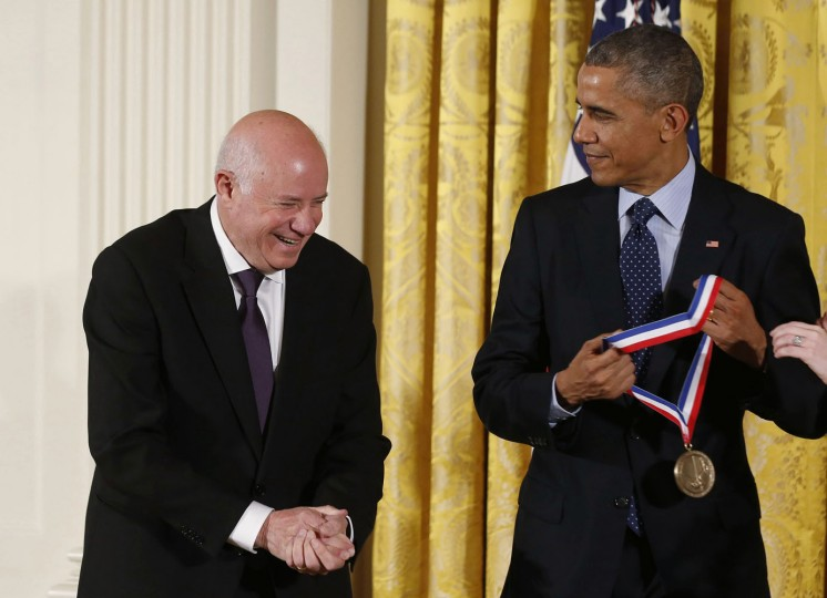 SanDisk Corp. founder Eli Harari (L) smiles as U.S. President Barack Obama awards him with the National Medal of Technology and Innovation at a ceremony in the East Room of the White House in Washington November 20, 2014. Harari was the inventor of flash storage technology. (Larry Downing/Reuters)