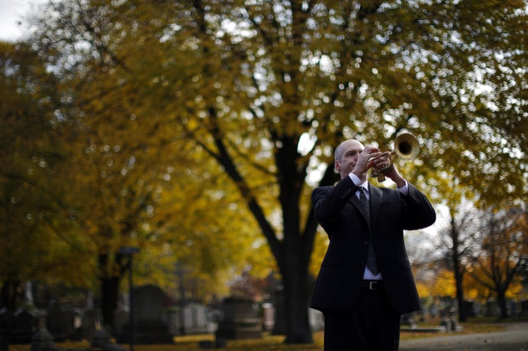 "Robinson Pyle plays ""Taps"" during Veterans Day ceremonies in Cambridge, Massachusetts November 11, 2014. (Brian Snyder/Reuters photo)"