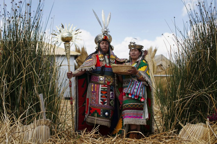 An Andean man and a woman, depicting Inca's legendary characters Manco Capac and Mama Ocllo, pose for a portrait in a Uros island at Lake Titicaca before a re-enactment in Puno on November 5, 2014. (REUTERS/Enrique Castro-Mendivil)