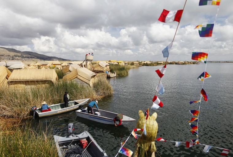 Andeans prepare their boats at the shores of a Uros island at Lake Titicaca in Puno on November 5, 2014. (REUTERS/Enrique Castro-Mendivil)