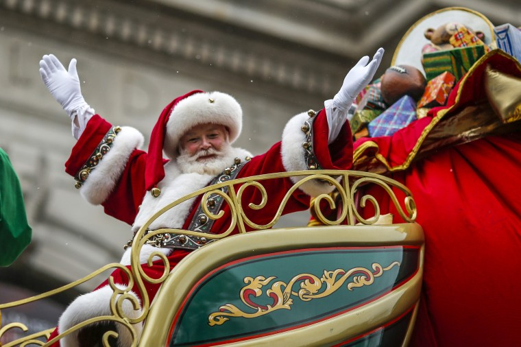 A man dressed as Santa Claus waves as he rides on his float down Central Park West during the 88th Macy's Thanksgiving Day Parade in New York. (REUTERS/Eduardo Munoz)