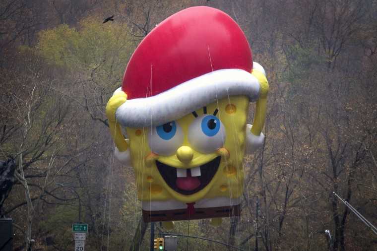 The Sponge Bob Squarepants float makes its way down 6th Ave during the Macy's Thanksgiving Day Parade in New York. (REUTERS/Carlo Allegri)