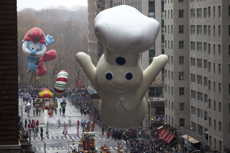 The Pillsbury Doughboy float makes its way down 6th Ave during the Macy's Thanksgiving Day Parade in New York. (REUTERS/Carlo Allegri)