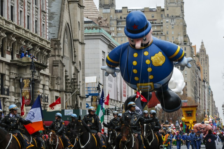 Keystone Cop balloon floats down Central Park West during the 88th Macy's Thanksgiving Day Parade in New York. (REUTERS/Eduardo Munoz)