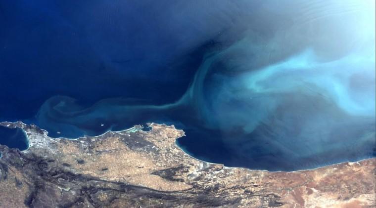 Wild swirling ocean currents in sunlight near Cape Town, South Africa on October 18. (Reid Wiseman/NASA)