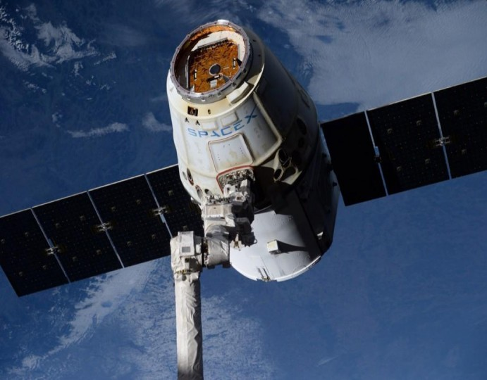 A space-weathered SpaceX Dragon moments before being released on October 25. The Dragon is a free-flying spacecraft designed to deliver cargo to orbiting destinations. (Reid Wiseman/NASA)