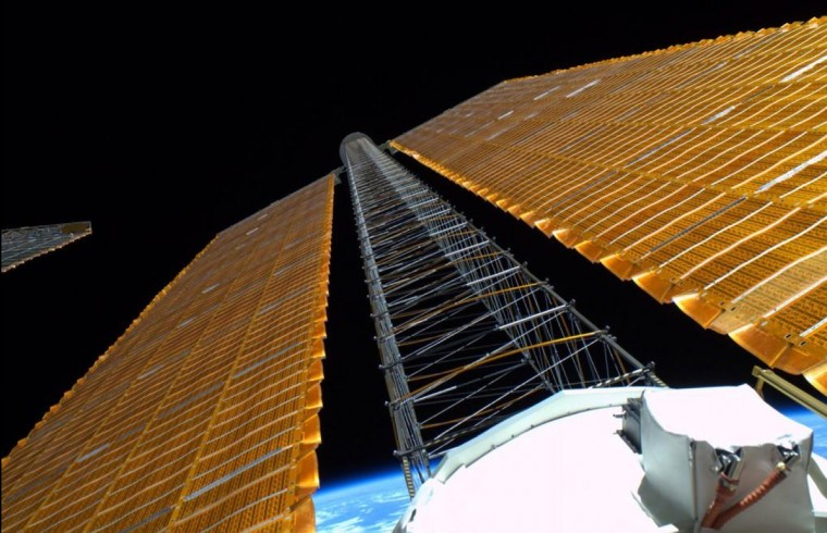 Unique perspective of an ISS solar array from a spacewalk on October 15. (Reid Wiseman/NASA)