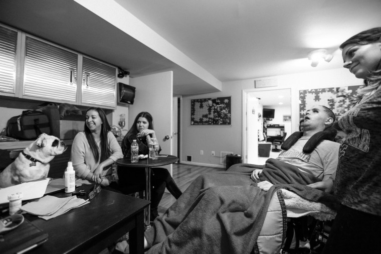 Ryan's college friends still come to visit him, even five years later. Sarah Butts, 24, Hannah Ellis, 24 and Emily Clift, 24, (right) sit around and joke about memorable times with Ryan. (Kaitlin Newman/For The Baltimore Sun)