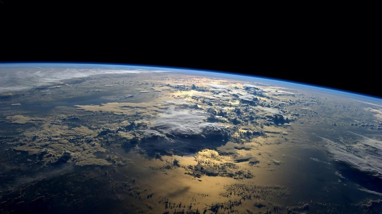 """NASA astronaut Reid Wiseman tweeted this photo from the International Space Station Sept. 2, 2014. """"My favorite views from space – just past sunrise over the ocean,"""" the Expedition 40 astronaut tweeted. (Reid Wiseman/NASA)"""
