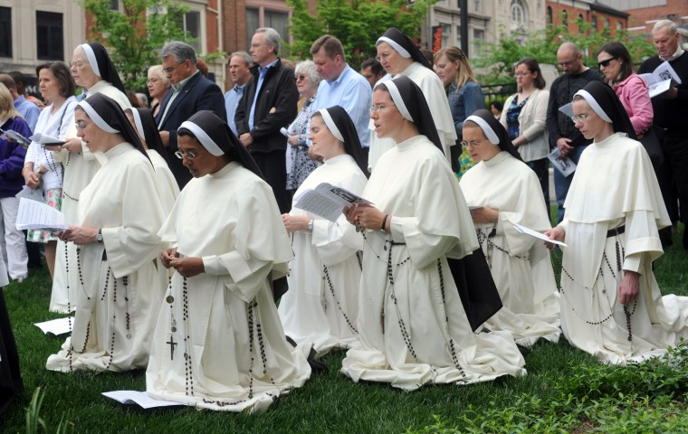 Dominican Sisters of Nashville, who teach in Baltimore at Mt. DeSales Academy, pray during a service and procession at the Pope John Paul II Memorial Prayer Garden in honor of the beatification of Pope John Paul II, May 1, 2011. (Barbara Haddock Taylor/file photo)