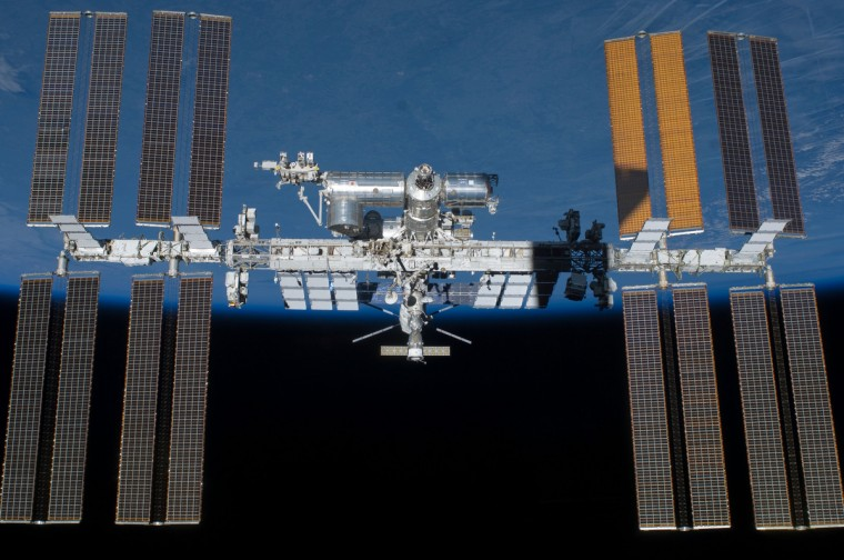 Backdropped by Earth's horizon and the blackness of space, the International Space Station is featured in this image photographed by an STS-134 crew member on the space shuttle Endeavour. (NASA photo)