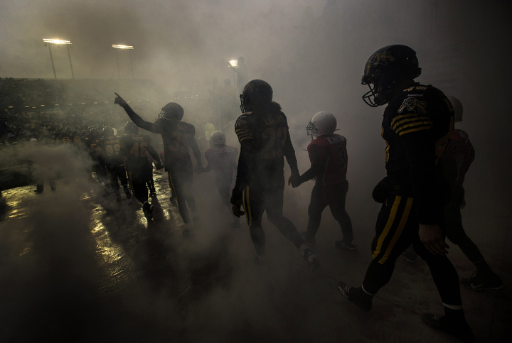 Hamilton Tiger-Cats players take the field against the Montreal Alouettes before their CFL football game in Hamilton, Canada. (Mark Blinch/Reuters)
