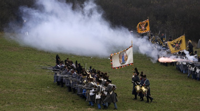 History enthusiasts, dressed as soldiers, fight during the re-enactment of Napoleon's famous battle of Austerlitz near the southern Moravian town of Slavkov u Brna. Hundreds of history enthusiasts took part in the re-enactment of the battle to mark its 209th anniversary. (David W. Cerny/Reuters)