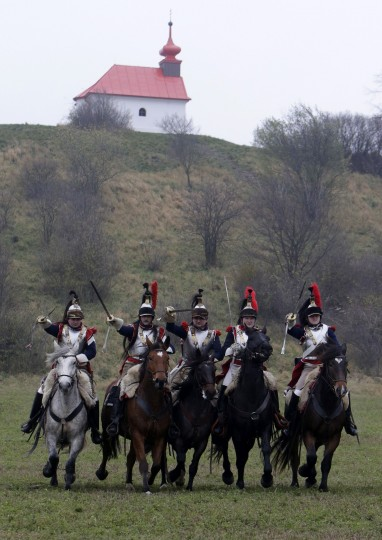 History enthusiasts, dressed as soldiers, fight during the re-enactment of Napoleon's famous battle of Austerlitz near the southern Moravian town of Slavkov u Brna. Hundreds of history enthusiasts took part in the re-enactment of the battle to mark its 209th anniversary. Reuters/David W Cerny. (David W. Cerny/Reuters)