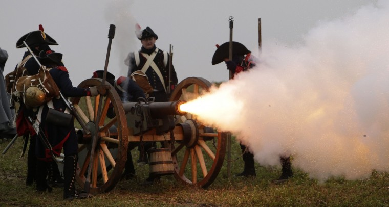 History enthusiasts, dressed as soldiers, fire a fake cannon during the re-enactment of Napoleon's famous battle of Austerlitz near the southern Moravian town of Slavkov u Brna. Hundreds of history enthusiasts took part in the re-enactment of the battle to mark its 209th anniversary. (David W Cerny/Reuters)