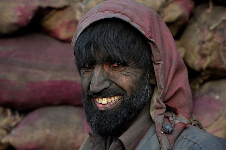 An Afghan day labourer look on as he works at a coal yard on the outskirts of Kabul. Afghanistan's economy has improved significantly since the fall of the Taliban regime in 2001 largely because of the infusion of international assistance. Despite significant improvement in the last decade the country is still extremely poor and remains highly dependent on foreign aid. (Noorullah Shirzada/AFP-Getty Images)