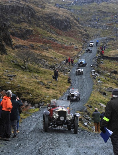 Competitors descend a hill during a vintage car rally stage at the Honister Slate Mine in the Lake District, England. The event, part of the Lakeland Trials, is held annually by the Vintage Sports Car Club and challenges drivers and their machines through hairpin bends and rocky terrain against a backdrop of awe-inspiring scenery. (Anna Gowthorpe/Getty Images)