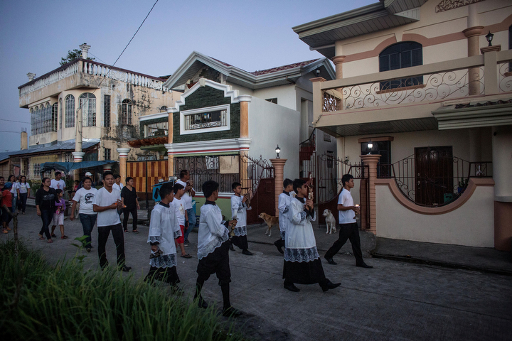 Residents of San Joaquin walk through the towns streets during a dawn candle light procession in Tacloban, Leyte, Philippines. Residents and typhoon survivors from across the central Philippines attended memorial services and visited mass graves honouring those who lost their lives one year ago when Typhoon Haiyan, the strongest typhoon ever to make landfall swept across the region, leaving more than 6000 dead and many more homeless. (Chris McGrath/Getty Images)