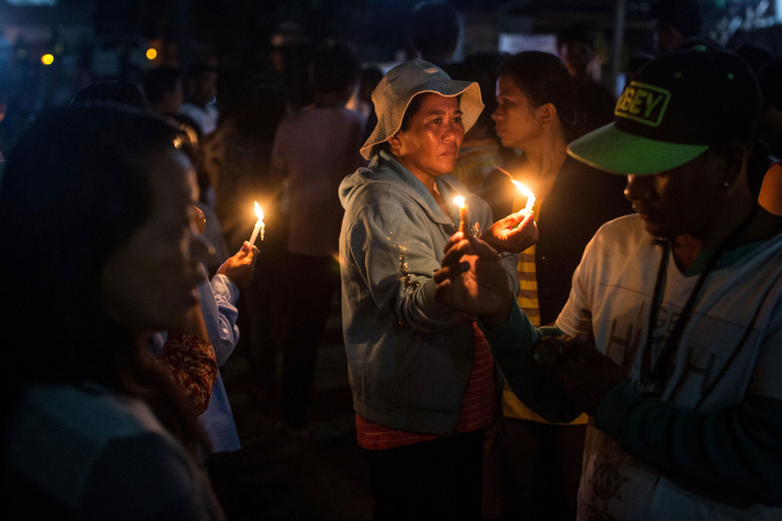 Residents of San Joaquin prepare to take part in a dawn candle light procession in Tacloban, Leyte, Philippines. Residents and typhoon survivors from across the central Philippines attended memorial services and visited mass graves honouring those who lost their lives one year ago when Typhoon Haiyan, the strongest typhoon ever to make landfall swept across the region, leaving more than 6000 dead and many more homeless. (Chris McGrath/Getty Images)