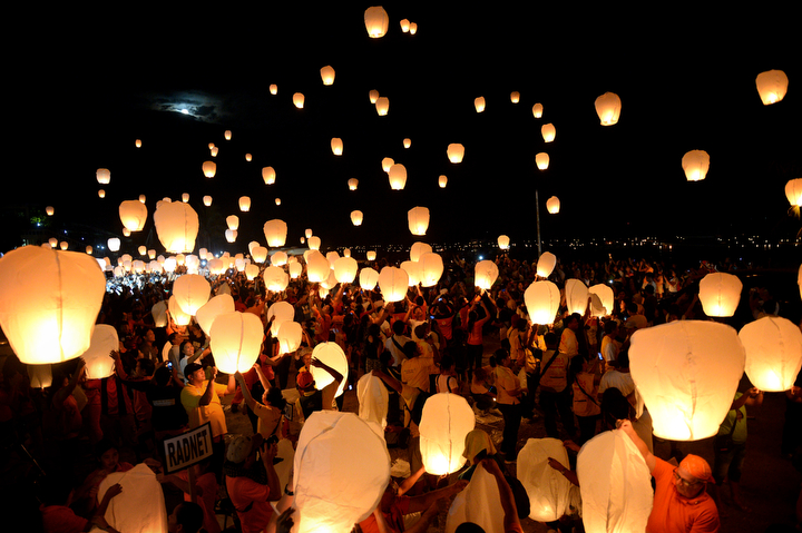 Residents and survivors release lanterns as part of the memorial service to commemorate the first year anniversary of the devastating Typhoon Haiyan in Tacloban City, central Philippines. Survivors of the strongest typhoon ever to hit land wept at mass graves on November 8, during ceremonies to mark one year since the storm devastated the central Philippines and condemned millions to deeper poverty. (Ted Aljibe/AFP-Getty Images)