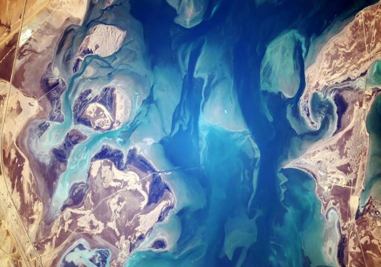 On November 3, Wiseman took this picture of coastal sands of Saudi Arabia blending with water just north of Jubail. (Reid Wiseman/NASA)