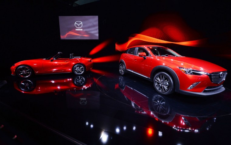 The Mazada CX-3 Crossover (R) and MX-5 Miata are unveiled at the Los Angeles Auto Show, November 19, 2014 in Los Angeles, California. (Robyn Beck/AFP/Getty Images)