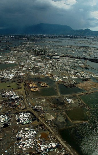As a band of rain begins (background left), aerial photo of Banda Aceh fails to capture the widespread scope of devastation as it only shows a portion of the acreage ripped apart Tuesday, Jan. 18, 2005 following a tsunami that swept through the town in December. (Karl Merton Ferron, Baltimore Sun)
