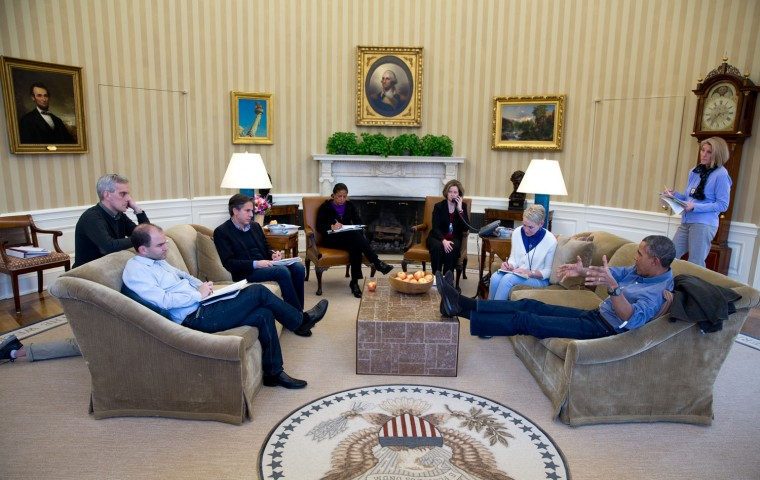 """March 1, 2014 """"The President talks with some of his national security advisors before a phone call with Russian President Vladimir Putin about the situation in Ukraine. I'm sure there will be people quick to comment about his wearing casual clothes and having his feet on his coffee table. Let's keep perspective in mind: it was a Saturday, and a President is the President whether he's wearing a suit on a weekday or casual clothes on a weekend. And a President, any President, isn't disrespecting the office if he puts his feet on a table or a desk; he's just being relaxed."""" (Official White House Photo by Pete Souza)"""