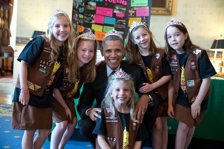 """May 24, 2014 """"This photograph was from the annual White House Science Fair. It shows the President posing with Girl Scout Troop 2612 in Tulsa, Oklahoma. I think the eight-year-old girlsÐAvery Dodson, Natalie Hurley, Miriam Schaffer, Claire Winton and Lucy Claire SharpÐare called 'Brownies'. They had just shown the President their exhibit: a Lego flood proof bridge project. The fair celebrated the student winners of a broad range of science, technology, engineering and math (STEM) competitions from across the country."""" (Official White House Photo by Pete Souza)"""