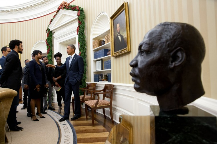 """Dec. 1, 2014 """"Following the outcry over the shooting of Michael Brown by a policeman in Ferguson, Missouri, the President invited young civil rights leaders to a meeting in the Oval Office. Many of them had protested in Ferguson. A 30-minute scheduled meeting last more than an hour. As the meeting broke up, the President continued the conversation for a few minutes and I then managed to frame the bust of Martin Luther King, Jr. in the foreground."""" (Official White House Photo by Pete Souza)"""