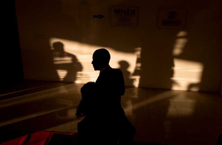 """Nov. 13, 2014 """"I almost tripped coming down the stairs trying to make this photograph as the President turned the corner at the bottom of the stairs coming into this beautiful light casting shadows and and his silhouette at the Parliamentary Resource Center in Naypyitaw, Burma."""" (Official White House Photo by Pete Souza)"""