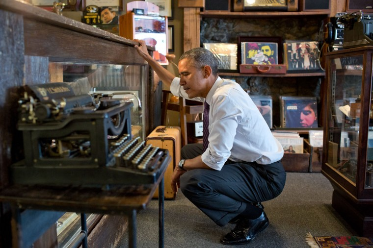 """July 30, 2014 """"I'm including this photograph because the President just loved looking around at Cool Vintage Watches in Parkville, Missouri. 'A lot of cool stuff,' was how he described it to me afterwards. He said he could have spent a lot more time looking around in the shop, which had much more than just watches."""" (Official White House Photo by Pete Souza)"""