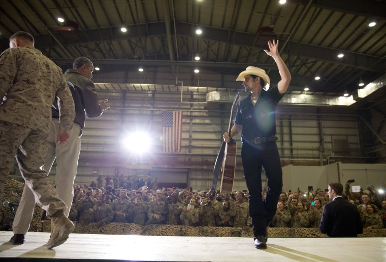 """May 25, 2014 """"A big shout-out to country singer Brad Paisley after he performed for U.S. troops before the President spoke at a rally at Bagram Airfield in Afghanistan. Brad traveled with us on Air Force One to Afghanistan, which meant for security purposes he couldn't tell anyone where he was going. Brad was genuinely a great traveling companion and even played guitar and sang Happy Birthday to one of the Air Force One crew members on the return flight."""" (Official White House Photo by Pete Souza)"""