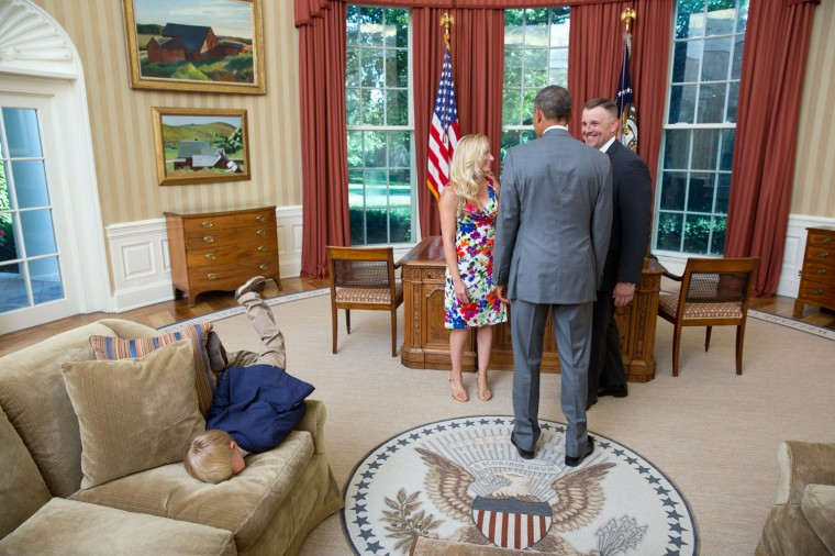 """June 23, 2014 """"This was a photograph that went viral when we posted in on Flickr. Lawrence Jackson captured a young boy face-planting himself onto the sofa in the Oval Office as the President greeting his parentsÐa departing United States Secret Service agent and his wife."""" (Official White House Photo by Lawrence Jackson)"""