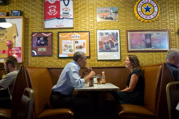 """June 26, 2014 """"The President shares a laugh while having lunch with Rebekah Erler at Matt's Bar in Minneapolis, Minnesota. Erler, a 36-year-old working wife and mother of two pre-school aged boys, had written the President a letter about the economic challenges of raising a family. When a trip to Minneapolis was scheduled, the President invited Rebekah to have lunch with him. He later met her family and the following day, Rebekah introduced the President at his economic speech."""" (Official White House Photo by Pete Souza)"""