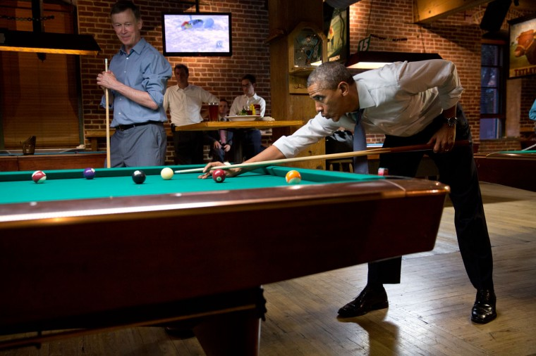"""July 8, 2014 """"The President whistles along to Van Morrison's 'Brown-Eyed Girl' while shooting pool with Colorado Gov. John Hickenlooper in Denver, Colorado. The President took great pride in beating the Governor at the bar the Governor founded."""" (Official White House Photo by Pete Souza)"""