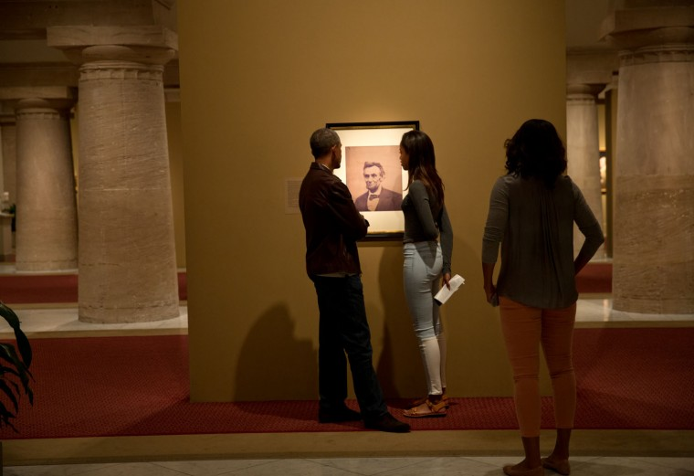 """Sept. 14, 2014 """"The President, First Lady, and daughter Malia view a portrait of Abraham Lincoln while visiting the National Portrait Gallery and Smithsonian American Art Museum in Washington, D.C."""" (Official White House Photo by Pete Souza)"""