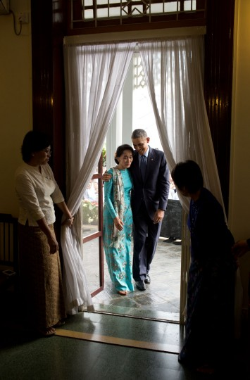 """Nov. 14, 2014 """"The President walks with Aung San Suu Kyi back into her residence following their joint press conference in Yangon, Burma."""" (Official White House Photo by Pete Souza)"""