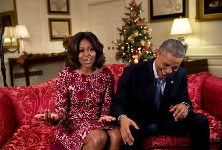 """Nov. 19, 2014 """"Lawrence Jackson captured the President busting out in laughter as he and the First Lady recorded a holiday video message in the Map Room of the White House."""" (Official White House Photo by Lawrence Jackson)"""