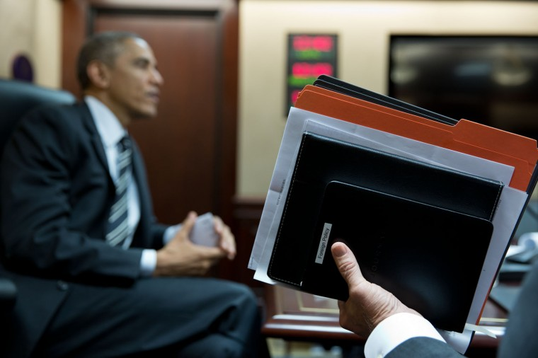 """Nov. 25, 2014 """"As a meeting in the Situation Room was about to break up, I focused on the Vice President's hand as he held up his briefing book and assorted folders."""" (Official White House Photo by Pete Souza)"""