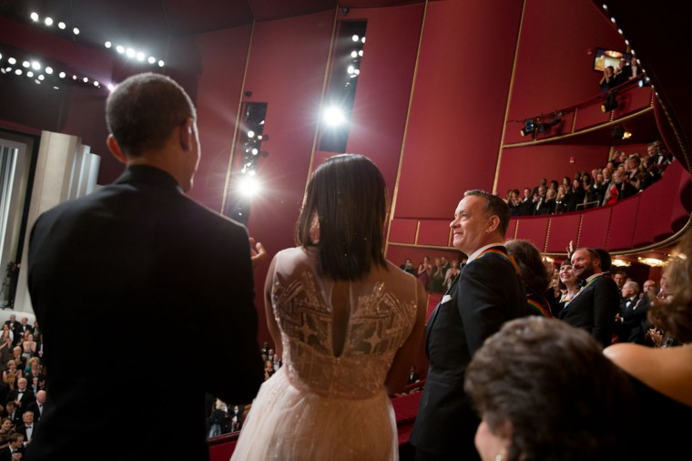 """Dec. 7, 2014 """"The President and First Lady applaud Tom Hanks, one of the honorees at the Kennedy Center Honors."""". (Official White House Photo by Pete Souza)"""