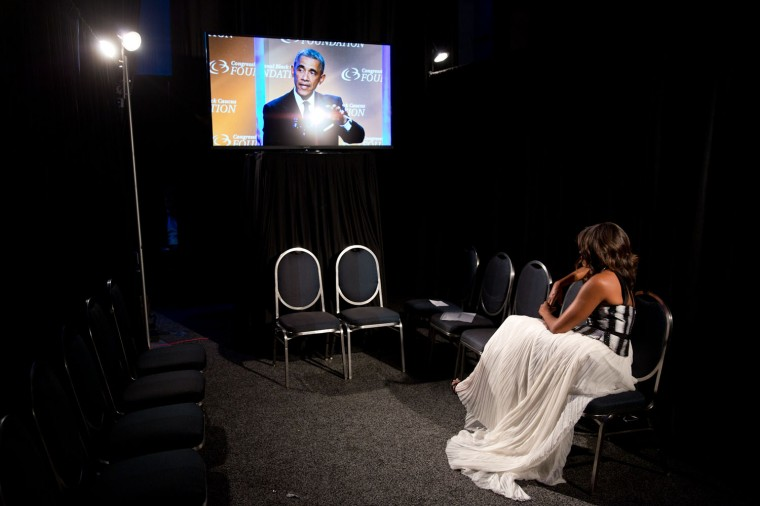 """Sept. 27, 2014 """"Lawrence Jackson captured the First Lady backstage watching the President deliver remarks at the Congressional Black Caucus Foundation's 44th Annual Legislative Conference Phoenix Awards Dinner in Washington, D.C. (Official White House Photo by Lawrence Jackson)"""