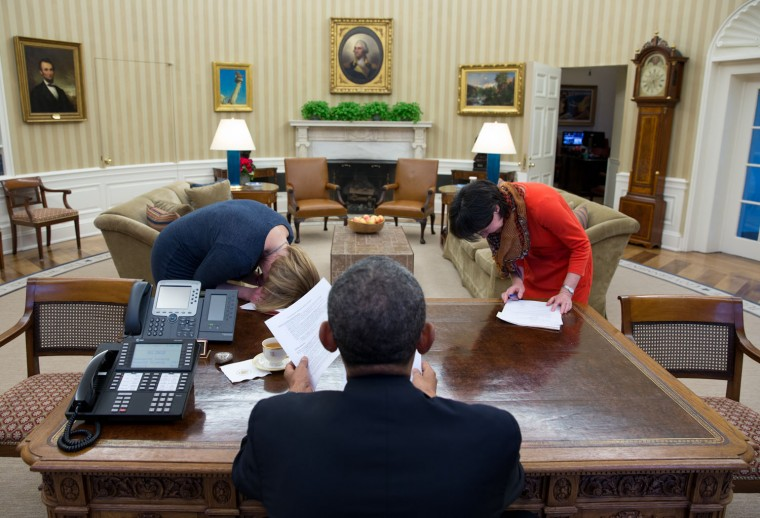 """Feb. 7, 2014 """"This is one of those photographs that needs some explanation. The President had been meeting with Communications Director Jennifer Palmieri, left, and Senior Communications Advisor Tara McGuinness, to prep for a radio interview. At one point, the President made a comment so humorous that Jenn and Tara bent over in laughter."""" (Official White House Photo by Pete Souza)"""