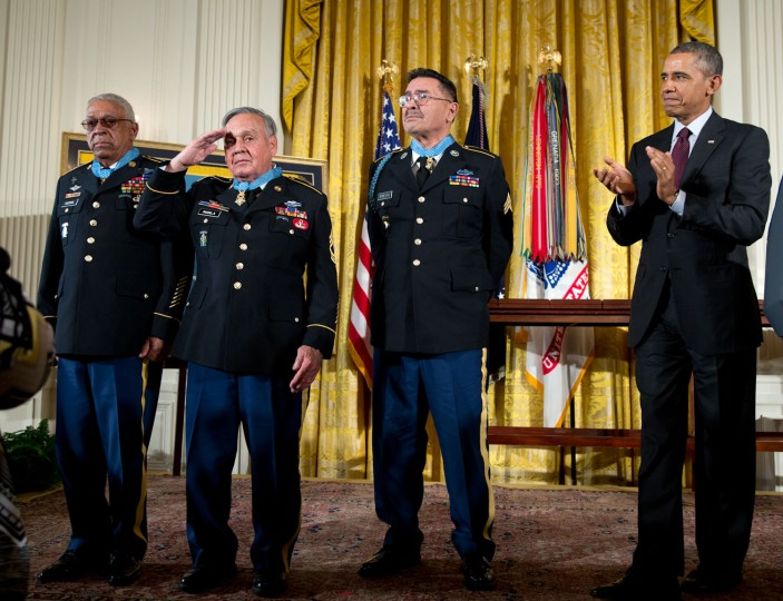 """March 18, 2014 """"The President applauds Medal of Honor honorees, from left, Staff Sergeant Melvin Morris, Sergeant First Class Jose Rodela, and Specialist Four Santiago J. Erevia, during the Medal of Honor ceremony in the East Room of the White House. The President awarded these three Army veterans plus 21others posthumously the Medal of Honor for conspicuous gallantry. These veterans received the Medal of Honor in recognition of their valor during major combat operations in World War II, the Korean War and the Vietnam War. Each of these soldiers' bravery was previously recognized with the award of the Distinguished Service Cross, the nation's second highest military award; that award was upgraded to the Medal of Honor in recognition of their gallantry, intrepidity and heroism above and beyond the call of duty. In 2002, Congress, through the Defense Authorization Act, called for a review of Jewish American and Hispanic American veteran war records from WWII, the Korean War and the Vietnam War, to ensure those deserving the Medal of Honor were not denied because of prejudice. During the review, records of several Soldiers of neither Jewish nor Hispanic descent were also found to display criteria worthy of the Medal of Honor. The 2002 Act was amended to allow these Soldiers to be honored with the upgrade - in addition to the Jewish and Hispanic American Soldiers."""" (Official White House Photo by Pete Souza)"""