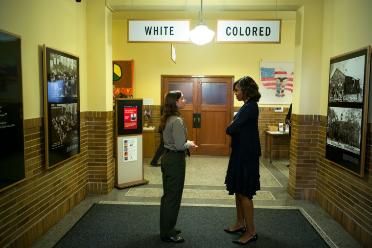 """May 16, 2014 """"A pretty self-explanatory moment by Chuck Kennedy, as the First Lady toured the Brown v. Board of Education National Historic Site in Topeka, Kansas, with Stephanie Kyriazis, Chief of Interpretation and Education."""" (Official White House Photo by Chuck Kennedy)"""
