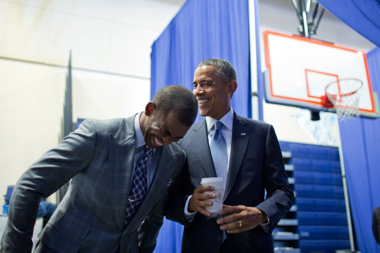 """July 21, 2014 """"The President shares a laugh backstage with Los Angeles Clippers basketball player Chris Paul, who was about to introduce the President at a 'My Brother's Keeper' initiative town hall in Washington, D.C. A few minutes before this photograph was taken, I was talking to Chris and he told me how nervous he was about doing the introduction. It surprised me that a basketball superstar, who plays under enormous pressure every night in front of tens of thousands of people, would be nervous. The President then came over and before long, had Chris cracking up in laughter to help put him at ease. I'll note that Chris did a great job in his introduction, and there were no visible signs of nervousness."""" (Official White House Photo by Pete Souza)"""