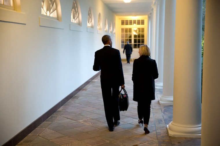 """Sept. 19, 2014 """"At the end of the day, the President walks along the White House colonnade with Anita Decker Breckenridge, Deputy Chief of Staff for Operations."""" (Official White House Photo by Pete Souza)"""