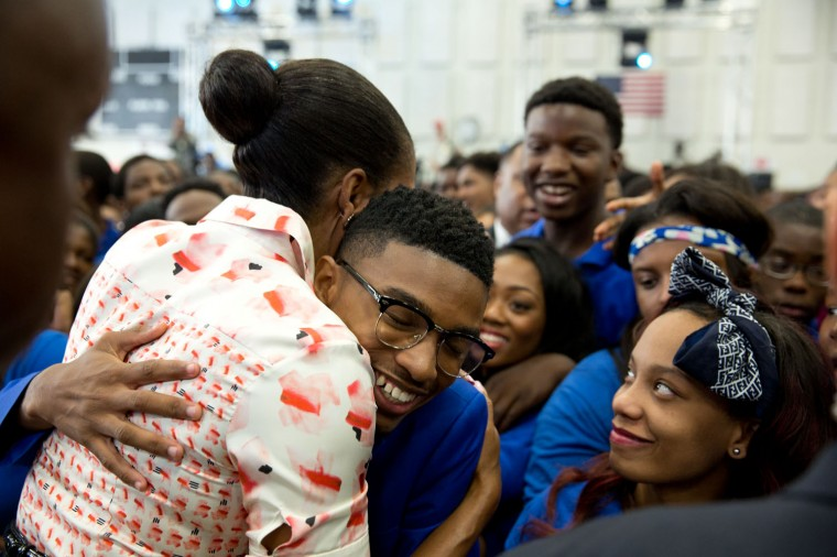 """Sept. 8, 2014 """"The First Lady is definitely a hugger. Chuck Kennedy captured this moment of her hug with someone in the audience following her remarks in support of the Reach Higher initiative in Atlanta, Georgia."""" (Official White House Photo by Chuck Kennedy)"""