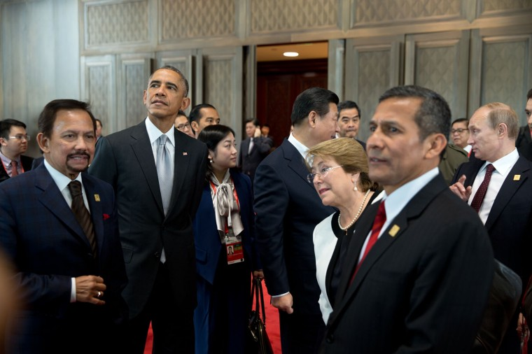 """Nov. 11, 2014 """"Access for me at foreign summits is usually quite limited. Somehow, I managed to be backstage with the President as he and other world leaders were waiting for the start of an Asia-Pacific Economic Cooperation (APEC) Plenary Session in Beijing, China."""" (Official White House Photo by Pete Souza)"""