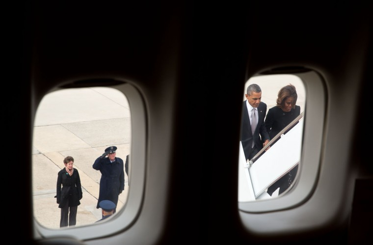 """March 7, 2014 """"I'm always looking for different angles to frame the President as he boards Air Force One. I hadn't thought about including this one of the President and First Lady until Netflix released a video promotion of Season 3 with a video clip eerily similar to this photograph."""" (Official White House Photo by Pete Souza)"""